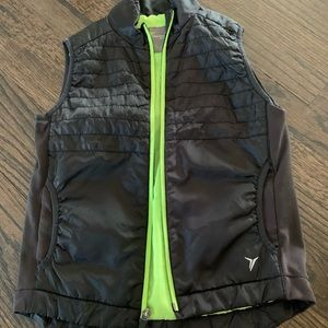 Black vest with neon green zipper, great quality